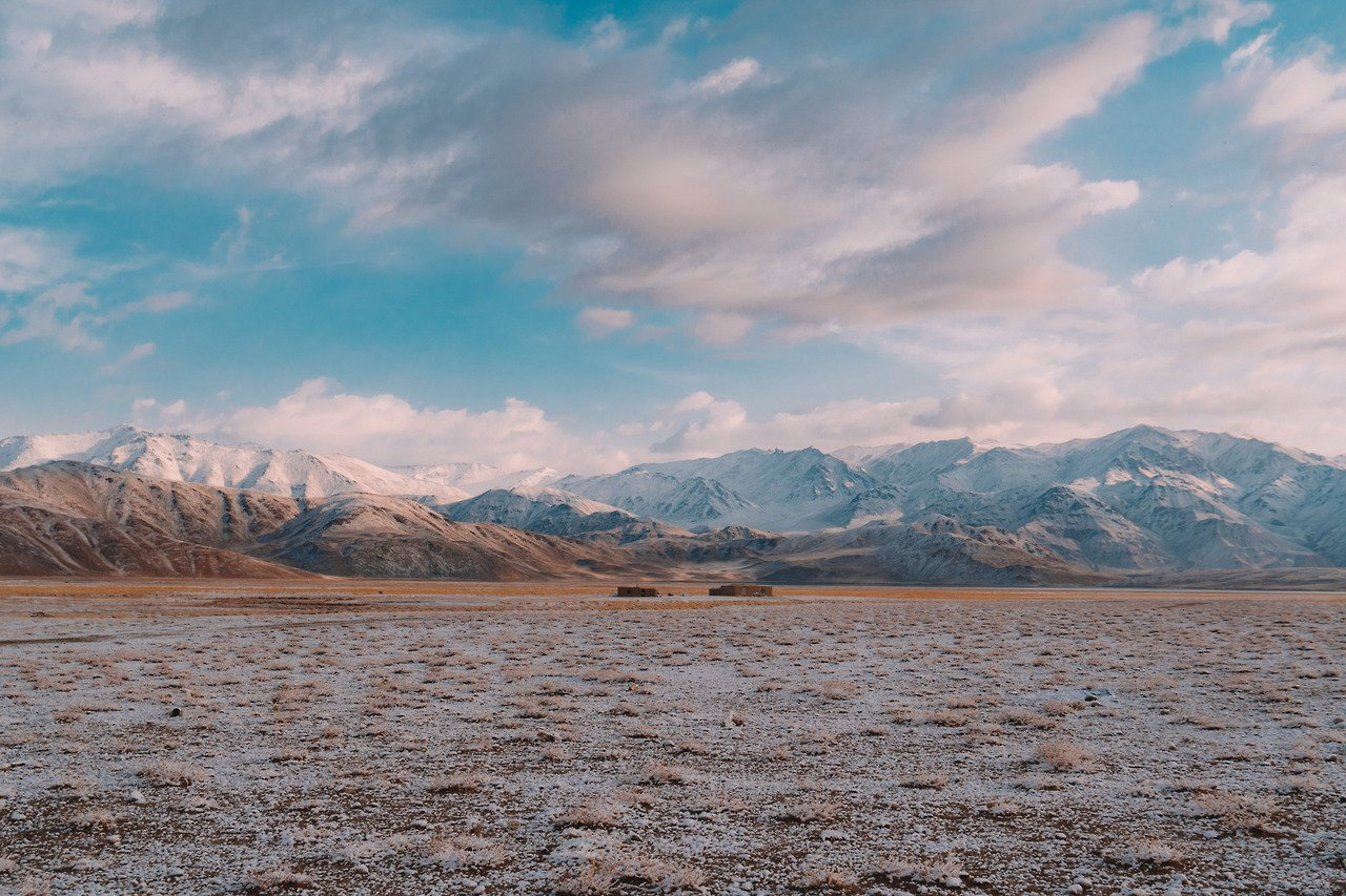 The snowy landscape of the Pamir Highway.