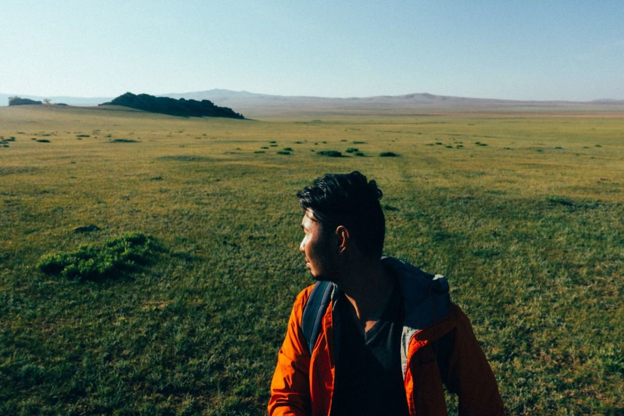 A person looking around at vast landscape in Monoglia