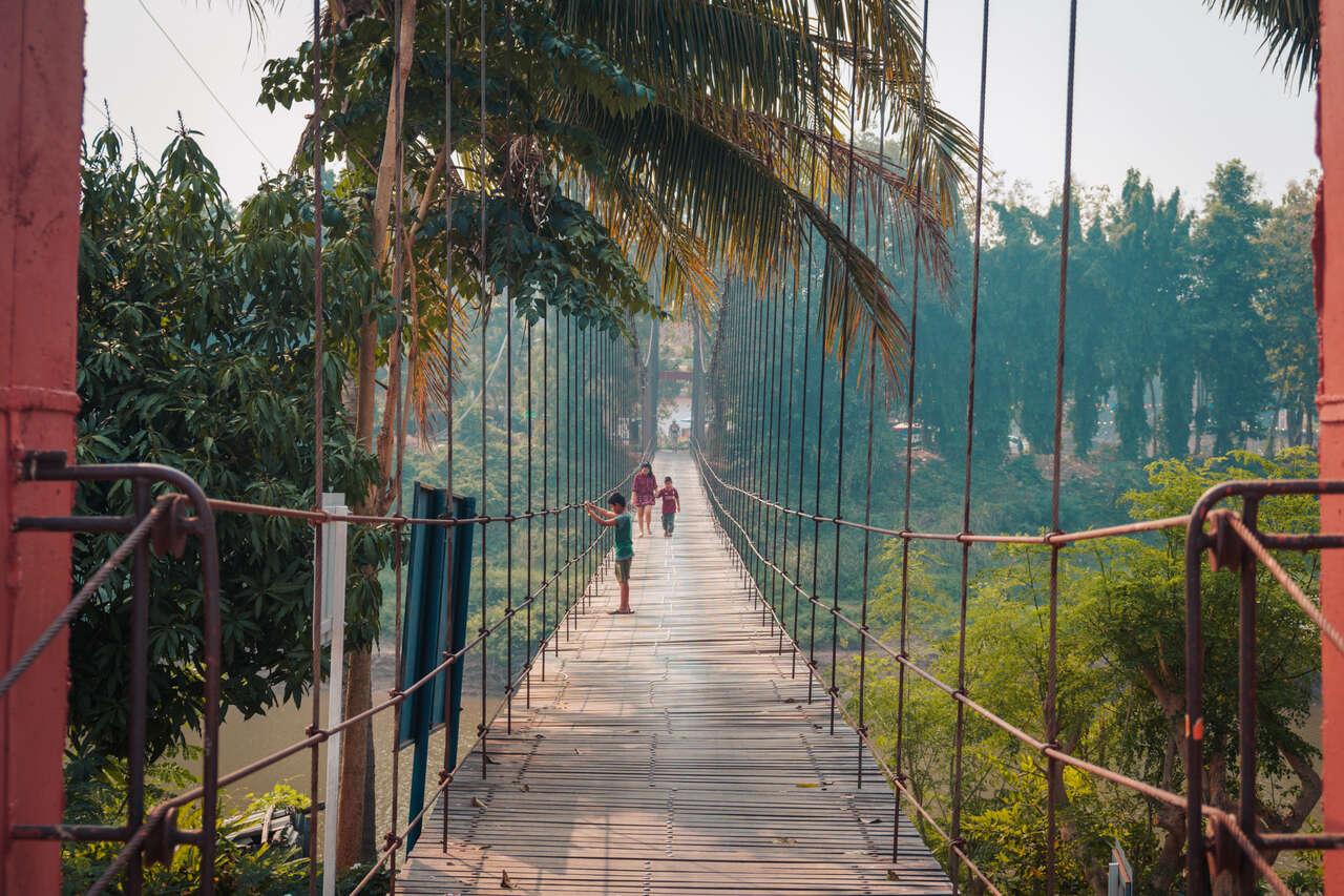 The Yom River Suspension bridge in Si Satchanalai, Thailand