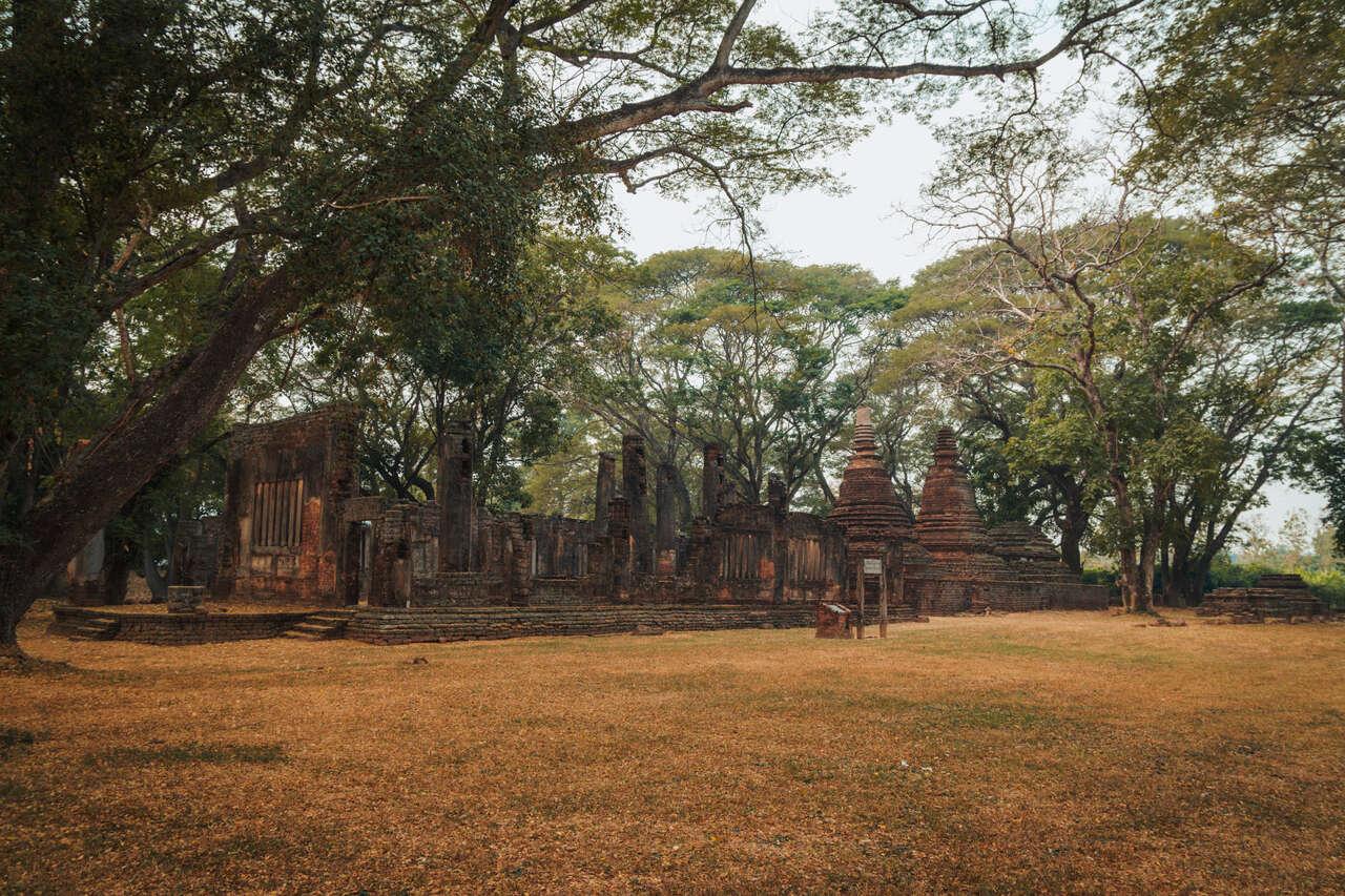 The exterior of Wat Khok Singkharam in Si Satchanalai, Thailand