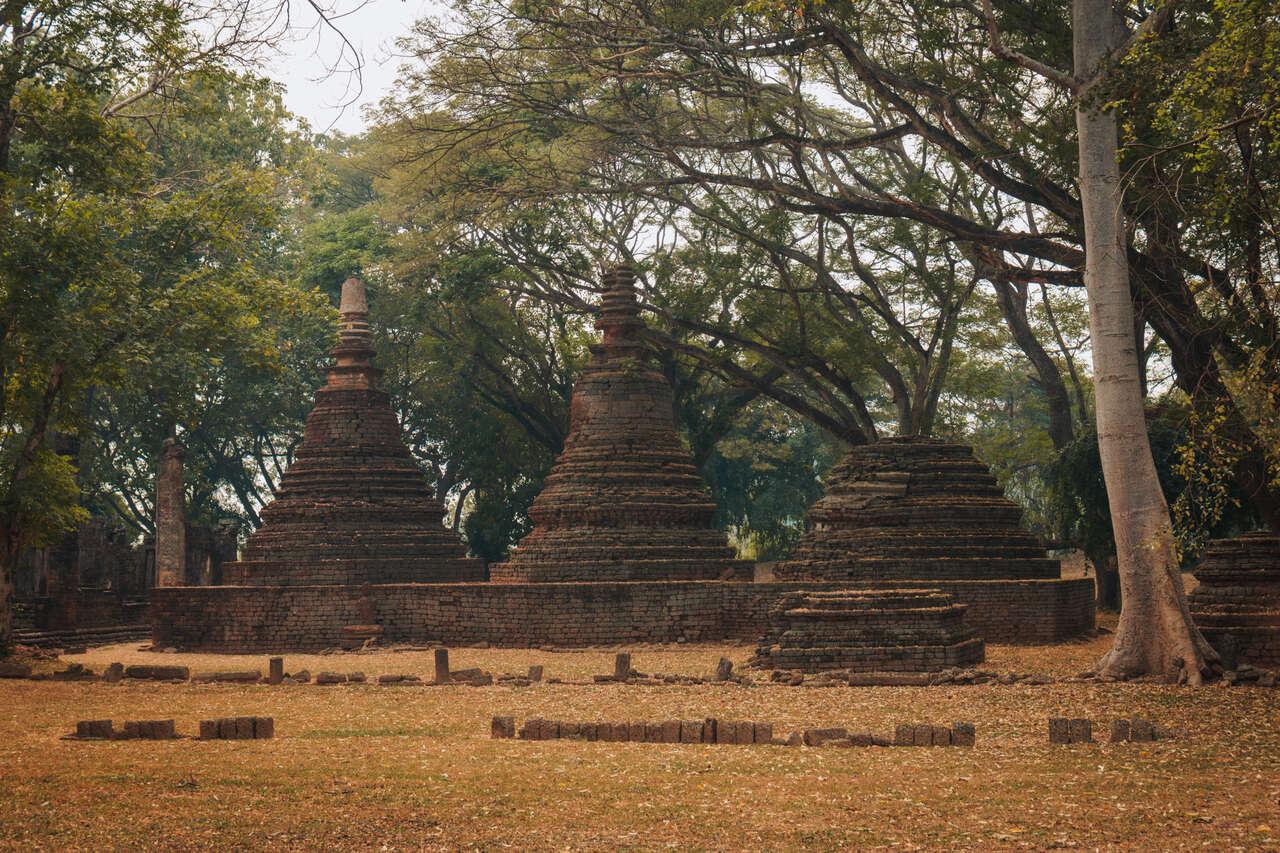 The pagodas of Wat Khok Singkharam in Si Satchanalai, Thailand