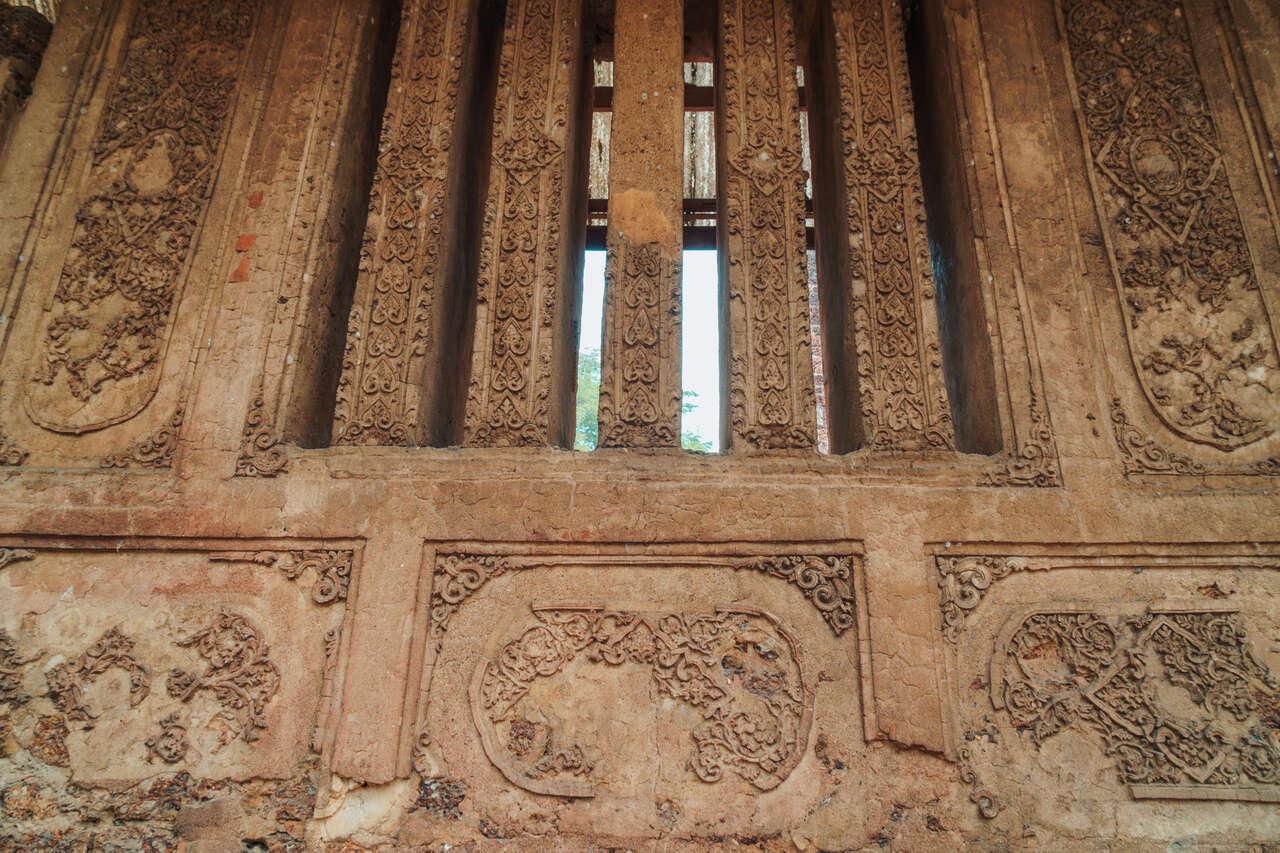 The Ayutthayan-style stucco reliefs at Wat Nang Phaya in Si Satchanalai, Thailand.