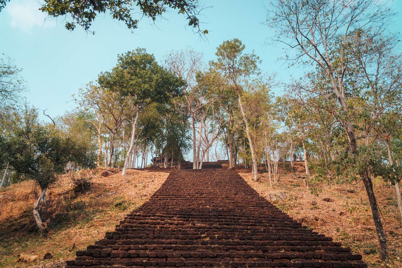 The steps leading up to Wat Khao Phanom Phloeng in Si Satchanalai, Thailand