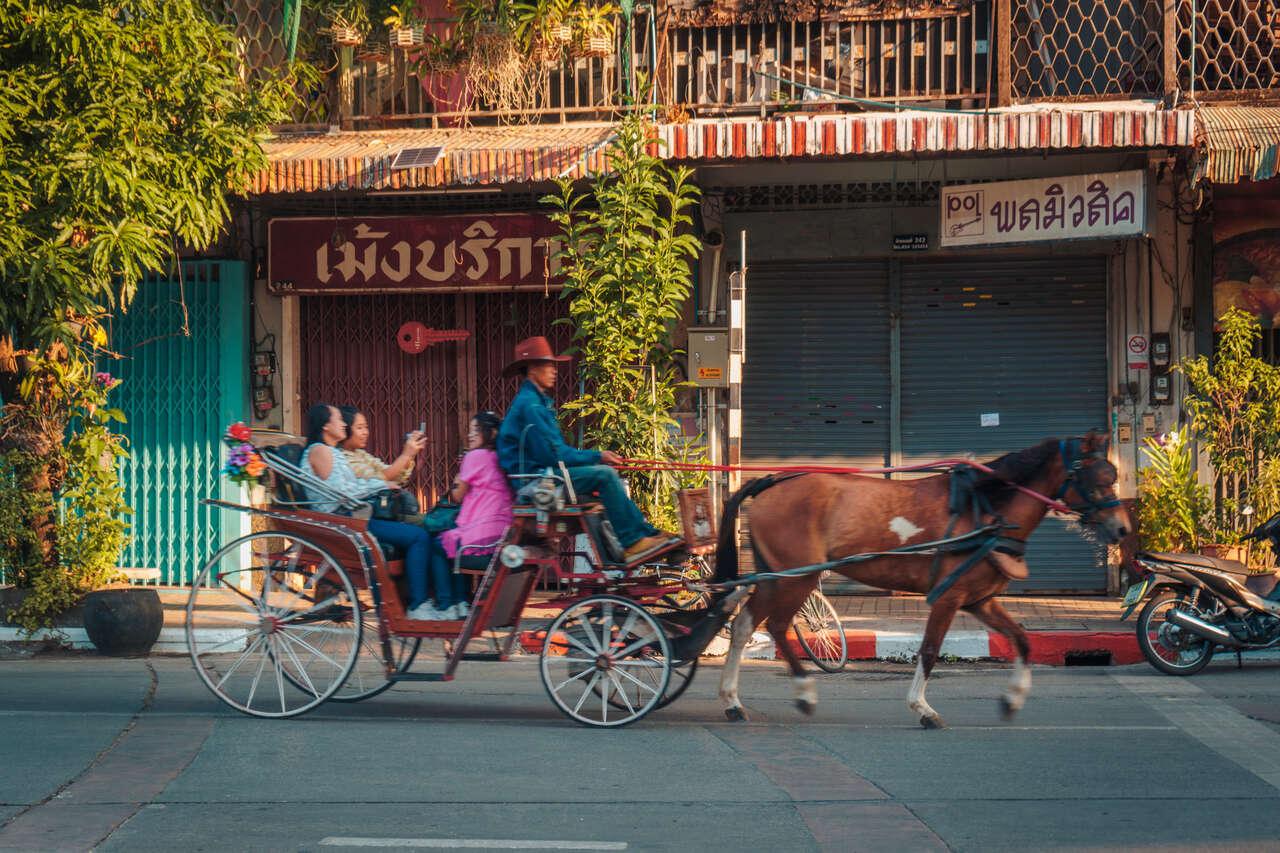 A horse cart running through the streets of Lampang, Thailand