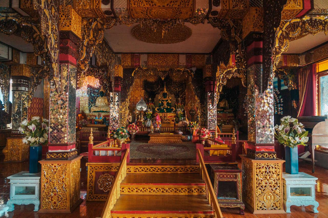 The Buddha image inside the assembly hall in Wat Chiang Rai, Lampang, Thailand.