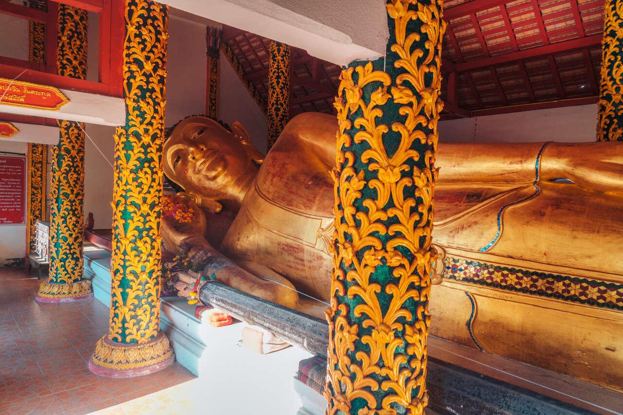 A reclining Buddha image inside Wat Pong Sanuk Nua in Lampang, Thailand.
