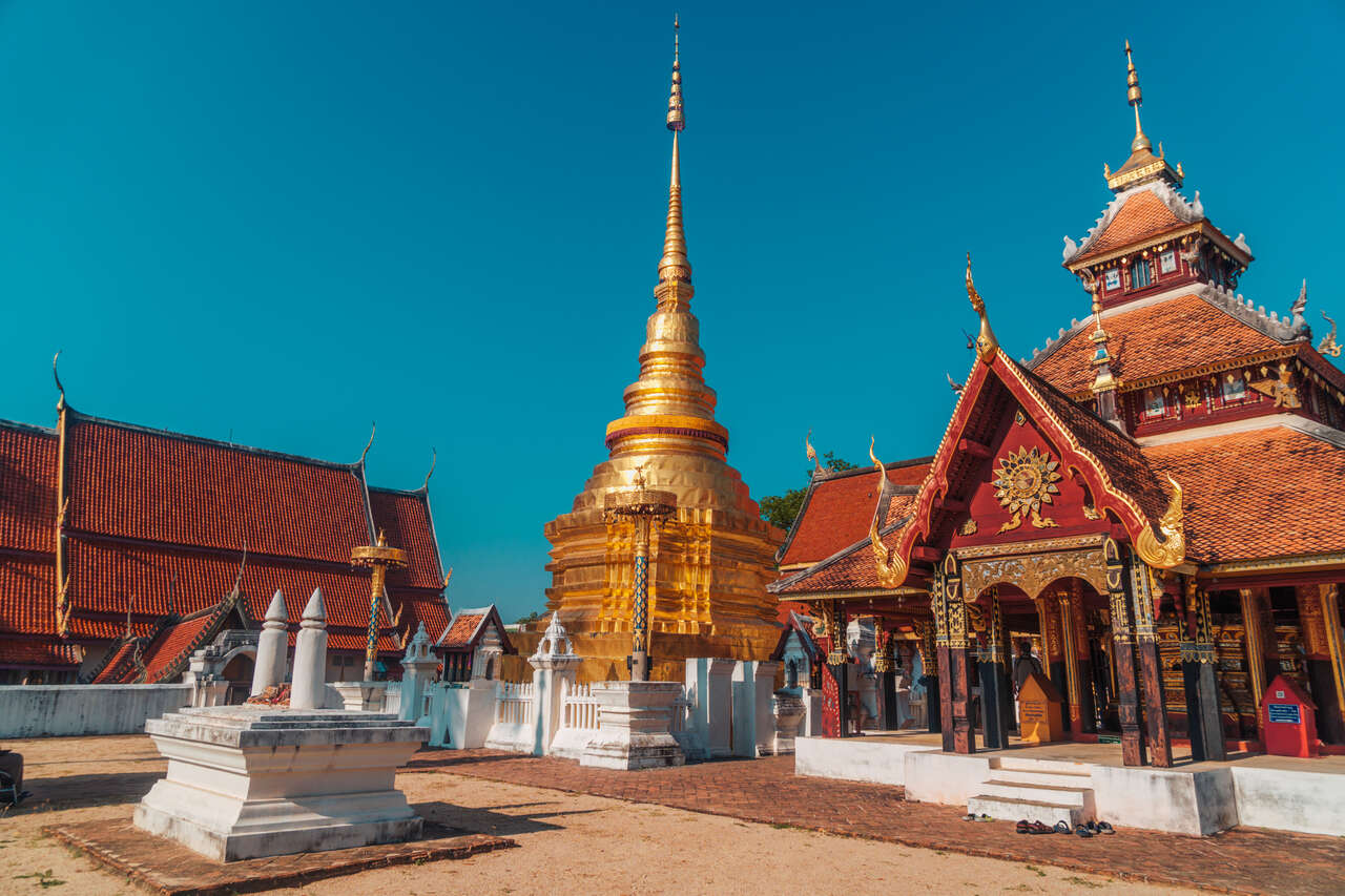 The temple courtyard of Wat Pong Sanuk Nua in Lampang, Thailand.