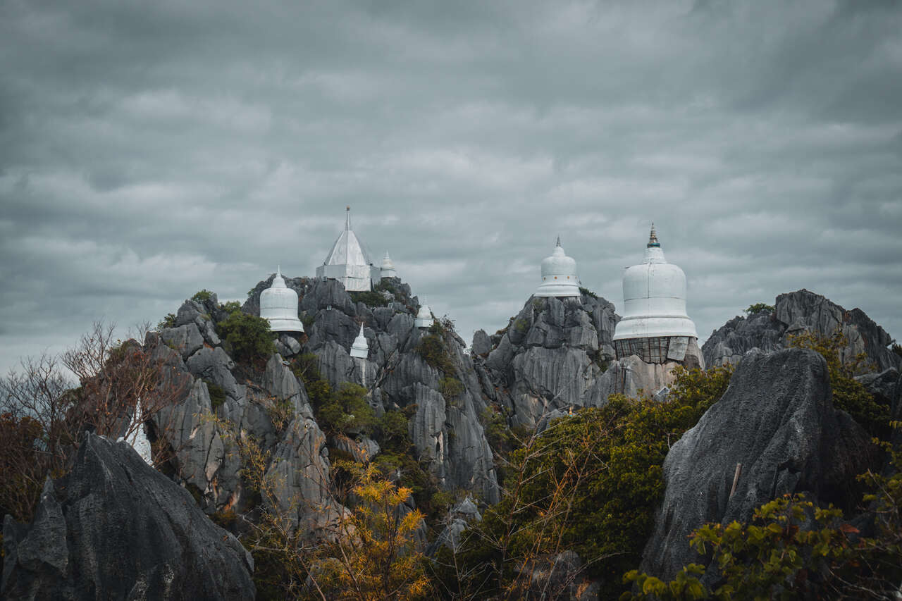 The white pagodas in the sky at Wat Chaloem Phra Kiat in Lampang, Thailand.