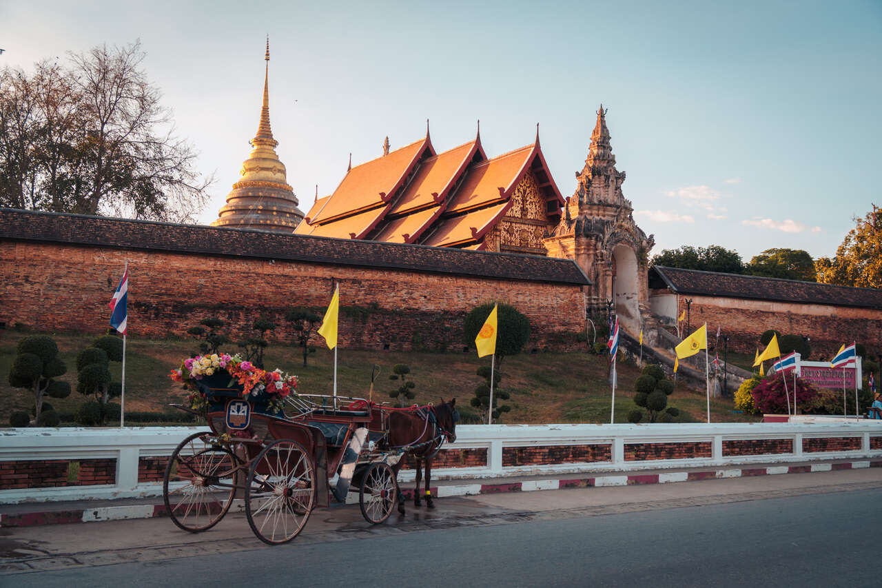 A horse cart in front of Wat Phra That Lampang Luang in Thailand.