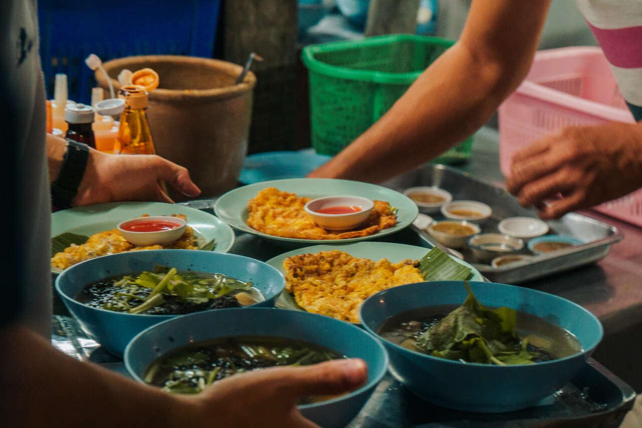 The servers preparing food at Aroy One Baht Restaurant in Lampang, Thailand.