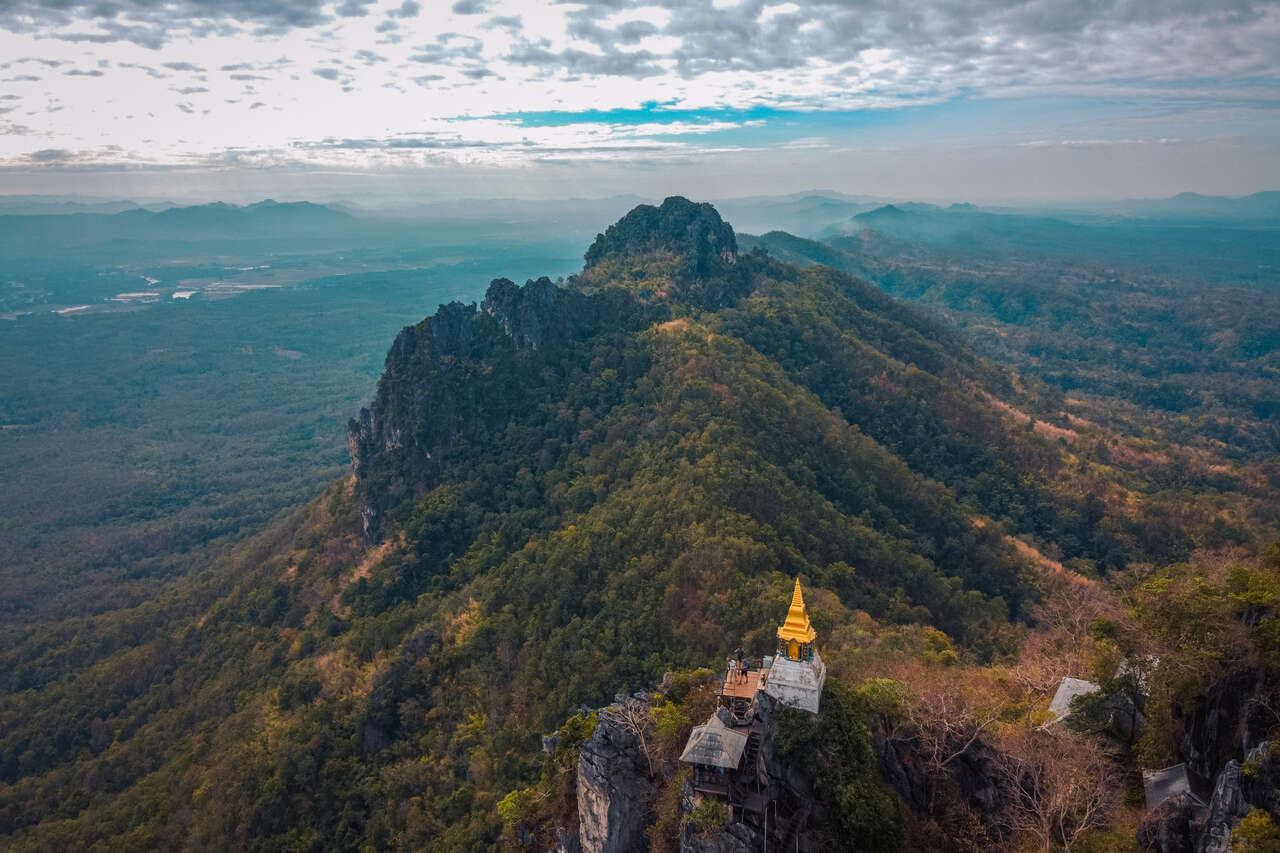 A pagoda on top of Wat Chaloem Phra Kiat from a drone in Lampang, Thailand.