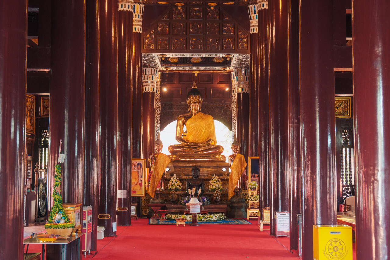 The interior of the teak wood temple at Wat Lok Moli in Chiang Mai, Thailand.