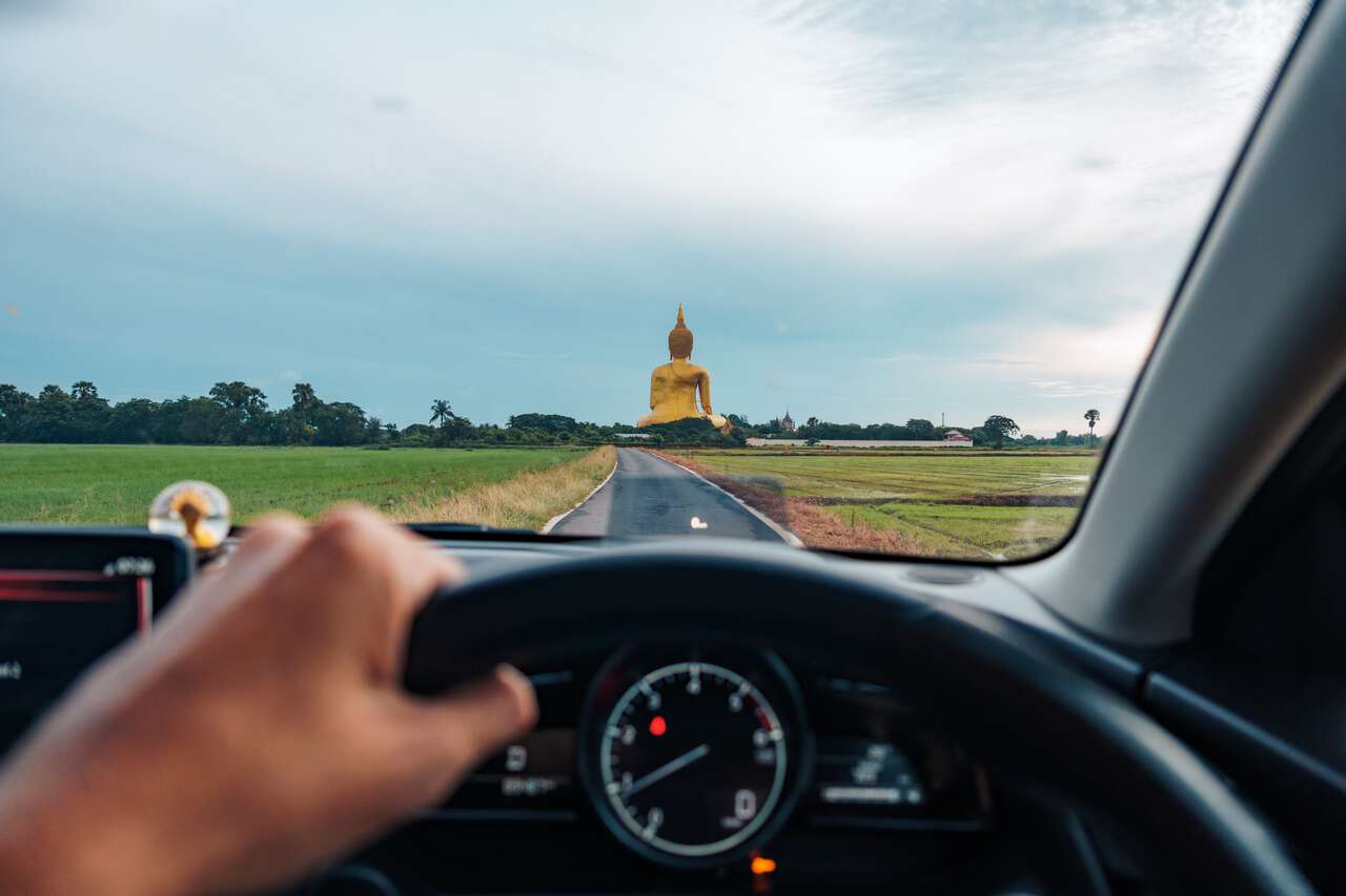 A driver driving towards the Great Buddha of Thailand in Ang Thong