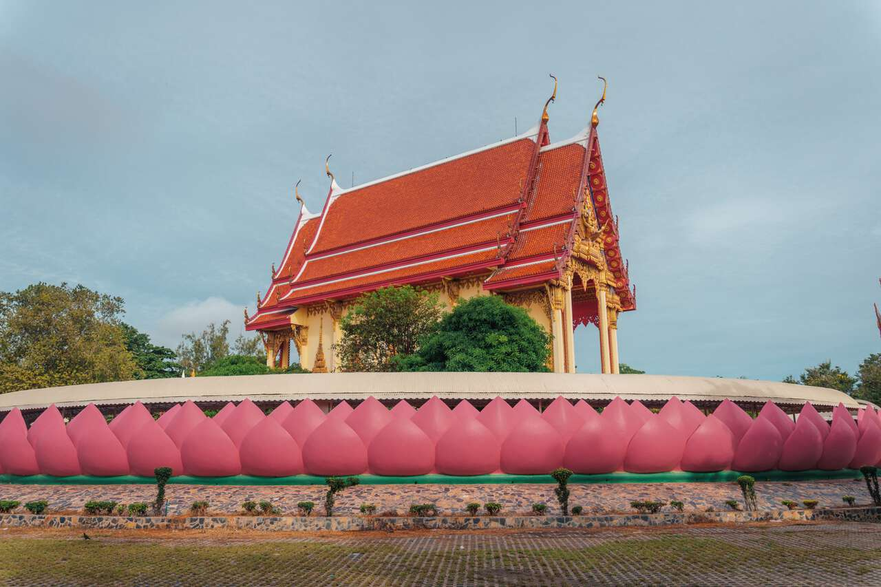 A temple elevated by Lotus shaped wall at Wat Muang in Ang Thong.