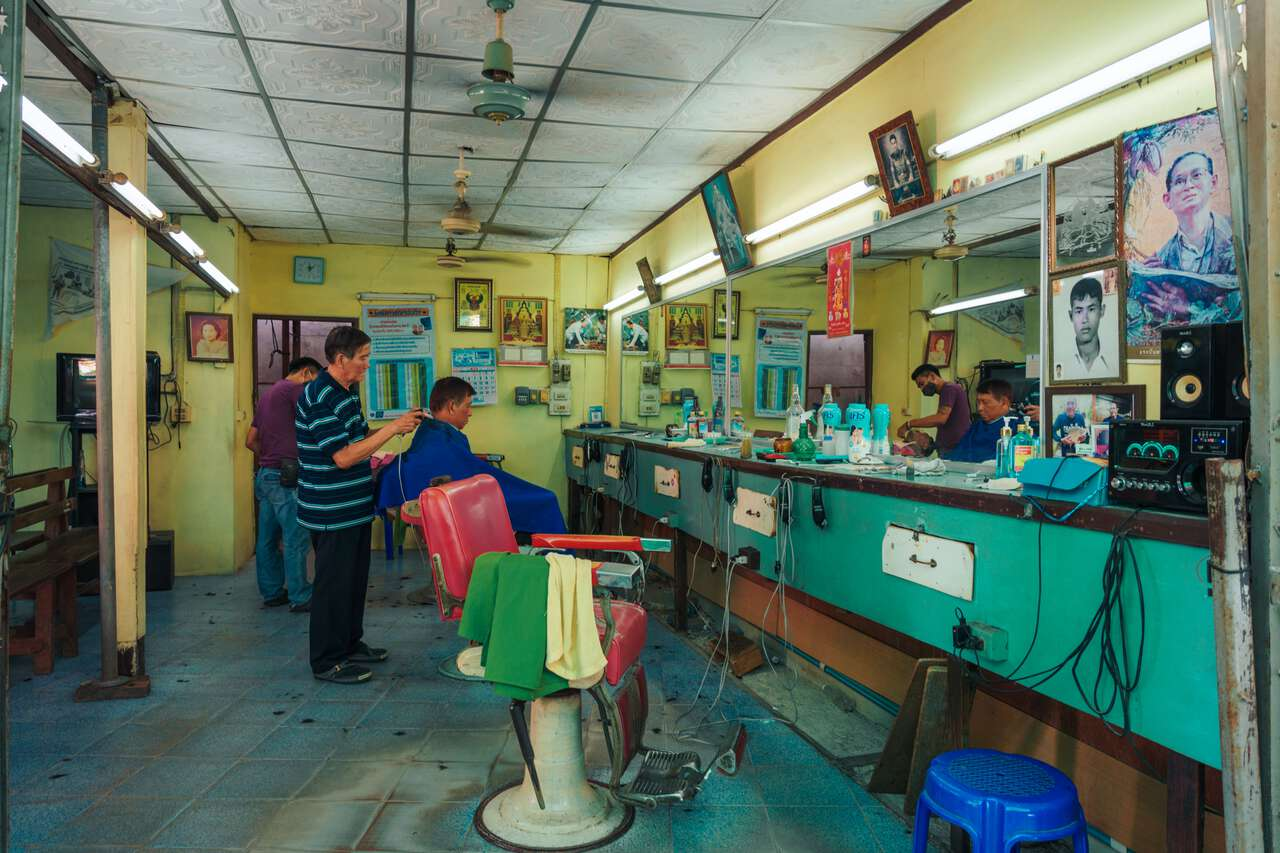 An old-school Thai-style barber at San Chao Rong Thong Vintage Market in Ang Thong