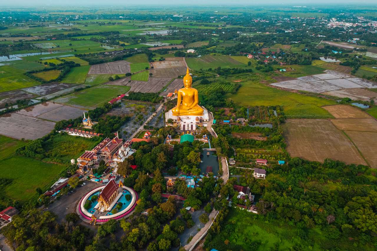An aerial view of the Great Buddha of Thailand and Wat Muang in Ang Thong